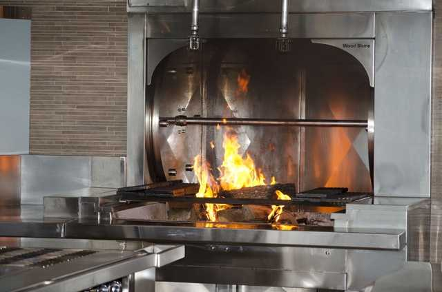 The onstage kitchen is all new, including space to hold the stack of wood for the wood-burning oven.