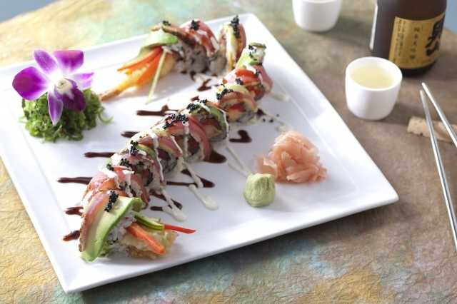 Dragon roll: Tempura shrimp, marinated tuna, seared tuna wasabi cream and spicy teriyaki