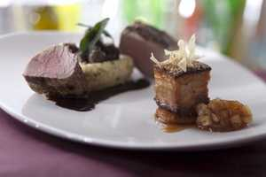 Pork two ways: Wood fire tenderloin with goat cheese polenta and braised lacquered belly and country applesauce
