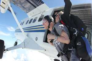 A 99-year-old man jumps out of a plane to raise money and awareness for research into Alzheimer's disease.