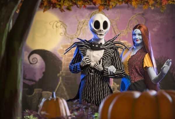 "The characters from ""Nightmare Before Christmas"" are greeting guests at the Town Square area of Main Street."