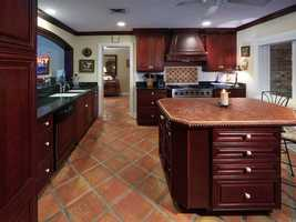 The kitchen features a very large custom island.