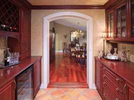 The kitchen not only features an open layout to the family room but also leads to the dining room.