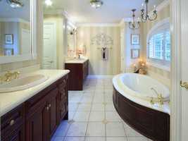 The master bedroom features dual vanities and a free-standing spa tub.
