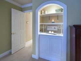 Custom cabinetry in each room.
