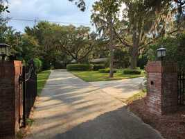 Iron gates guarantee privacy in your 0.96 acre slice of happiness.