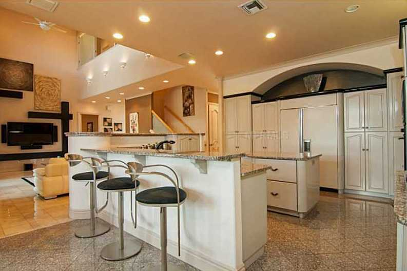 Large open kitchen area boasts granite counter tops, an abundance of solid wood Busby cabinets, prep island with refrigerator drawers, gas stove top, large dinette and much more.