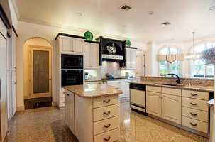 The kitchen features a granite island.