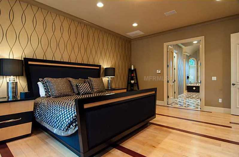 The luxurious property includes two master bedroom suites. The downstairs suite offers an office with a private patio with views of the lake, stately bedroom with sitting area, two walk-in closets & a grand master bathroom.