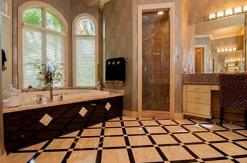 The bathroom with his/her vanities, walk-in shower and a jetted tub fit for royalty.