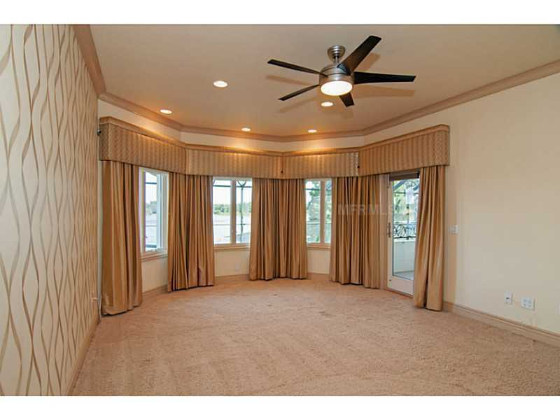The upstairs master has spectacular views of the lake and balcony access.