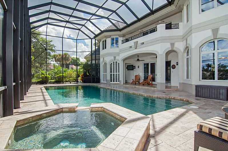 The outdoor space is great for entertaining, with 40' pool, spa, and travertine patio.