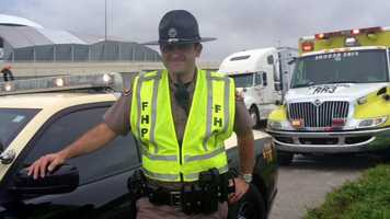 A Florida Highway Patrol trooper helped deliver a baby girl on the side of Interstate 4 near Tampa after stopping to investigate a crash Tuesday, troopers said.