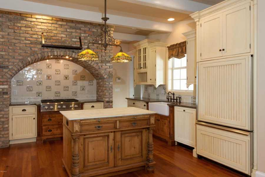 Alternate view of the timeless, rustic kitchen.