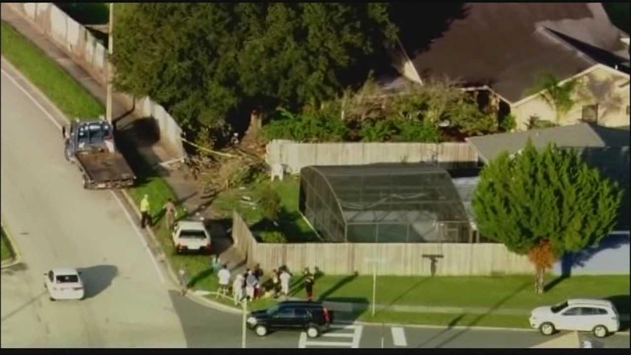 Car slams into fence