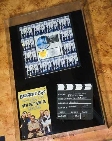 """Musical memorabilia, including the original slate board used in the 1995 Backstreet Boys video """"We've Got It Going On,"""" can be found throughout the venue."""