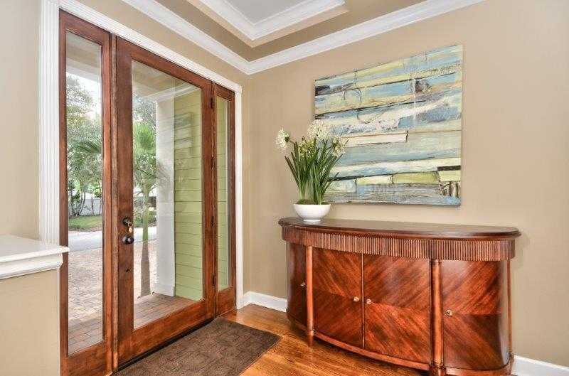 Modern and rustic foyer brings in plenty of natural light to the entrance of the home.