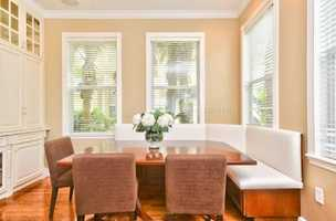 Breakfast nook features a plush, cushioned bench to enjoy many family meals.