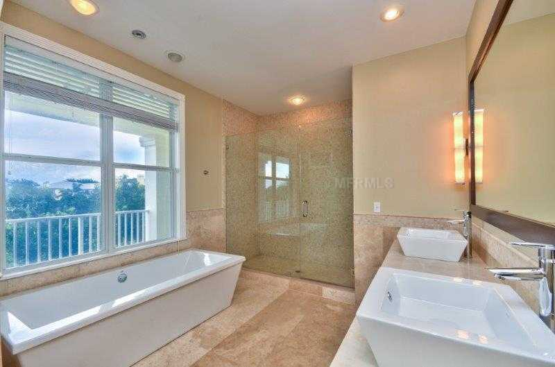 Master bedroom features a elongated, free-standing tub overlooking the spectacular view and a very spacious shower. Plus a dual vanity sinks.