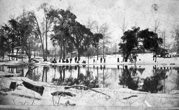 Snow around a lake in Jackson County, Florida. Photograph taken in 1895.