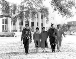 Students walking from the library in the snow at Florida State University.  Photograph taken in 1958.
