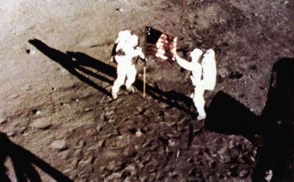 "Astronauts Neil Armstrong and Buzz Aldrin placing the American flag on the moon.  Photograph taken in 1969. ""That's one small step for man, one giant leap for mankind."" ~ Neil Armstrong"