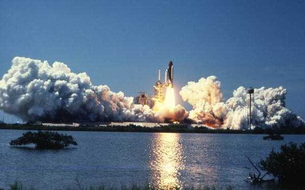 A space shuttle launching from Kennedy Space Center.  Photograph taken in the 1980s.