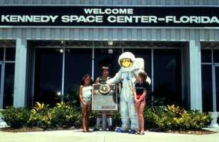 An astronaut in full-suit greeting visitors at the Kennedy Space Center.  Photograph taken in 1996.