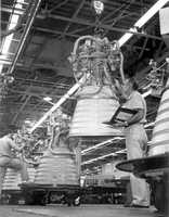 Scientists working on a liquid hydrogen fueled RL10 engine.  Date not provided.