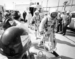 Astronauts about to board the Gemini 8 spacecraft.  Photograph taken in 1966.