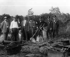 1925: Authorities destroy still found in Miami.