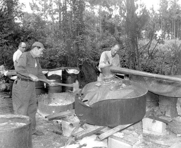 1953: A moonshine still being broke apart.