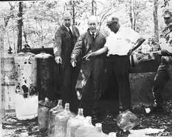 1964: Florida Gov. C. Ferris Bryant inspecting a still in Alachua County.