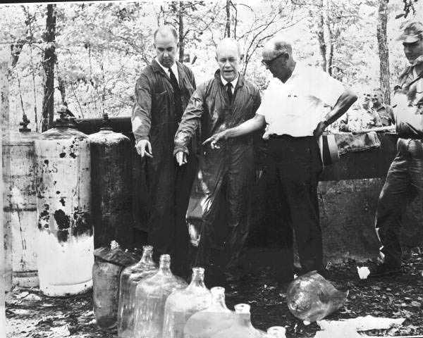 1964: Florida Gov. C. Ferris Bryant inspecting a still in Alachua County.