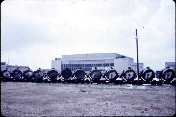 Giant search lights stored outside Hangar C in the 1960s.