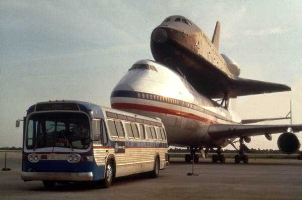 A space shuttle is displayed on the back of a shuttle carrier Boeing 747 aircraft in the 1990s.