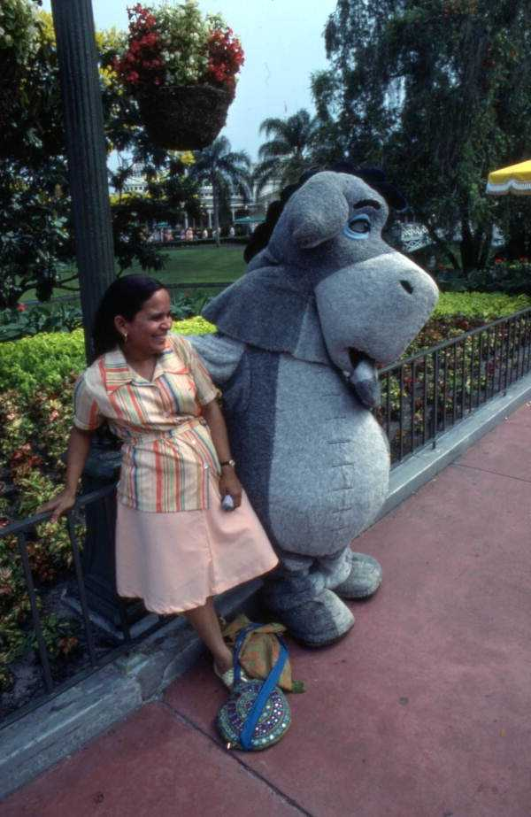 1977: Eeyore meets with a park guest.