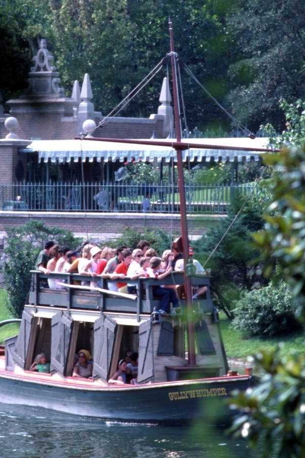 1977: The Gullywhumper boat in front of the Haunted Mansion attraction.  The boats navigated the waters surrounding Tom Sawyer's Island until April 29, 2001.