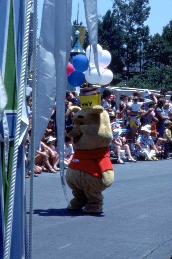 1977: Pooh walks the parade route inside the Magic Kingdom.