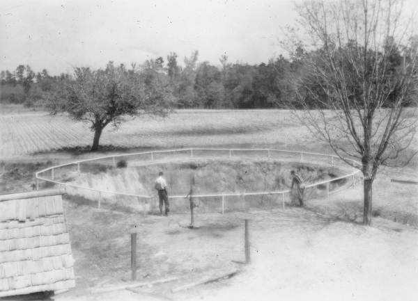 A sinkhole on Steve Bird's farm near Jasper, Fla.. Hamilton County in 1936.
