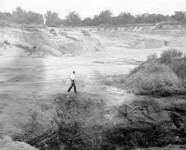 A man walks in a large sinkhole in Bartow (Date not known).