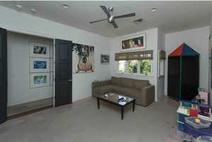 Upstairs also features a large playroom/media room with full bathroom.
