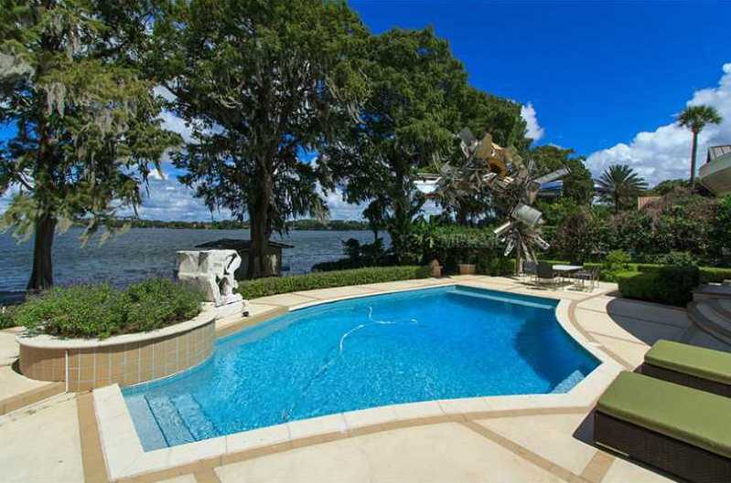A beautiful pool is steps from the property's boat deck.