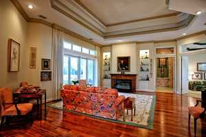 Beautiful molded ceilings make the living room a more dynamic space.