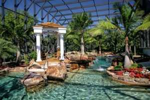 Can you believe this pool? Waterfalls, swim jet exerciser, and fountains create a tropical atmosphere. As an added bonus, the space is enclosed providing light, shade and more privacy.