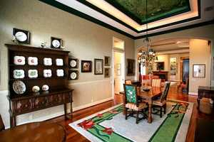 The dining room features an elegant, emerald ceiling mural.