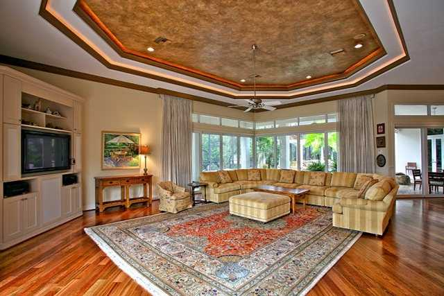 Another beautiful ceiling adds character to the room. The family room also features intracoastal waterway views and hardwood floors.