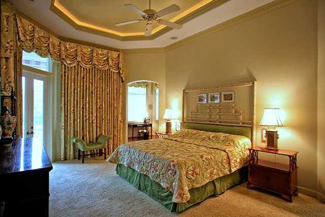 This master bedroom features private access to the pool area.