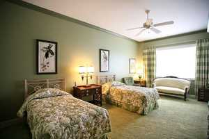 This guest room, also looks out over the waterway. Below the large window is a quaint sitting area.