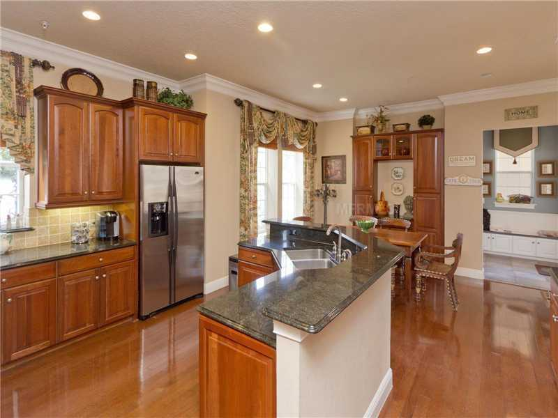 The kitchen features all top-of-the-line stainless appliances.